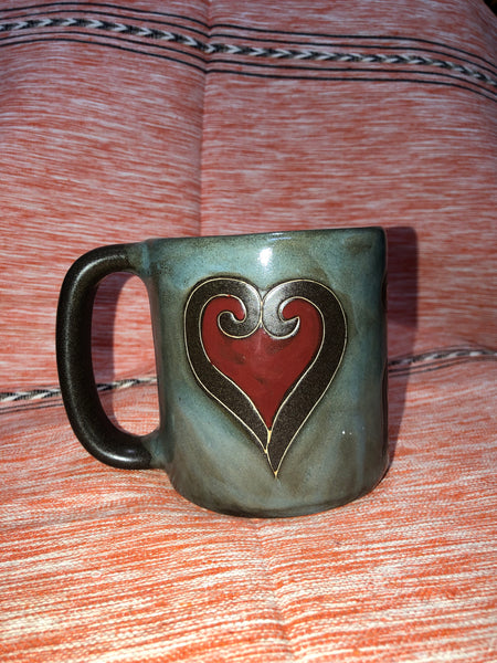 greenish mug with red heart on it.