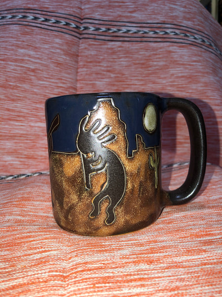 Kokopelli outdoors in midnight sky mug