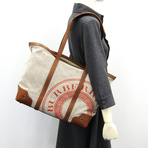 Buy & Consign Authentic Burberry Brown Canvas Leather Tote Bag at The Plush Posh