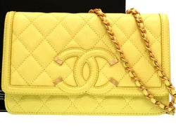 Buy & Consign Authentic Chanel Caviar Quilted CC Filigree Wallet On Chain WOC Yellow at The Plush Posh