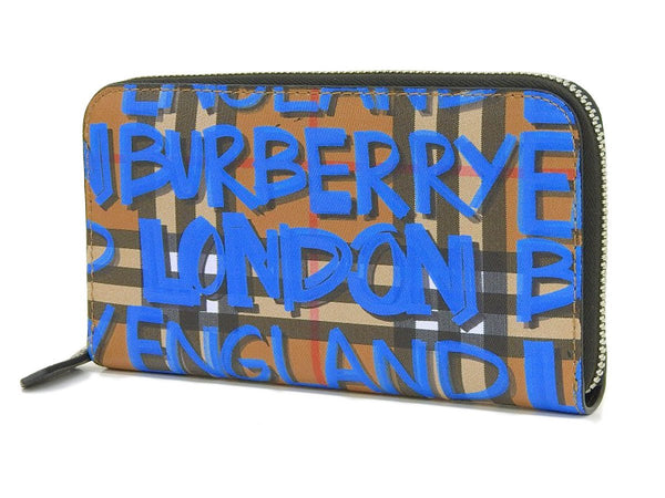 Buy & Consign Authentic Burberry Haymarket Graffiti Printed Zip Around Wallet Blue at The Plush Posh