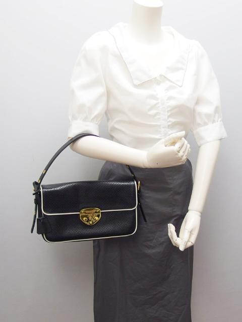 Buy & Consign Authentic Prada punching leather shoulder bag Black at The Plush Posh