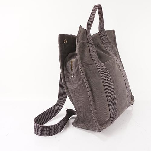 Buy & Consign Authentic Hermes Her Line Canvas Backpack Grey at The Plush Posh