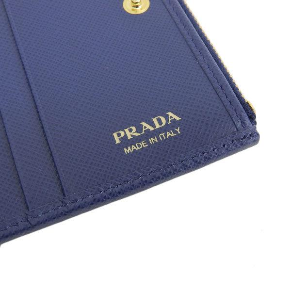 Buy & Consign Authentic Prada Safiano Leather Bi-Fold Wallet Blue at The Plush Posh