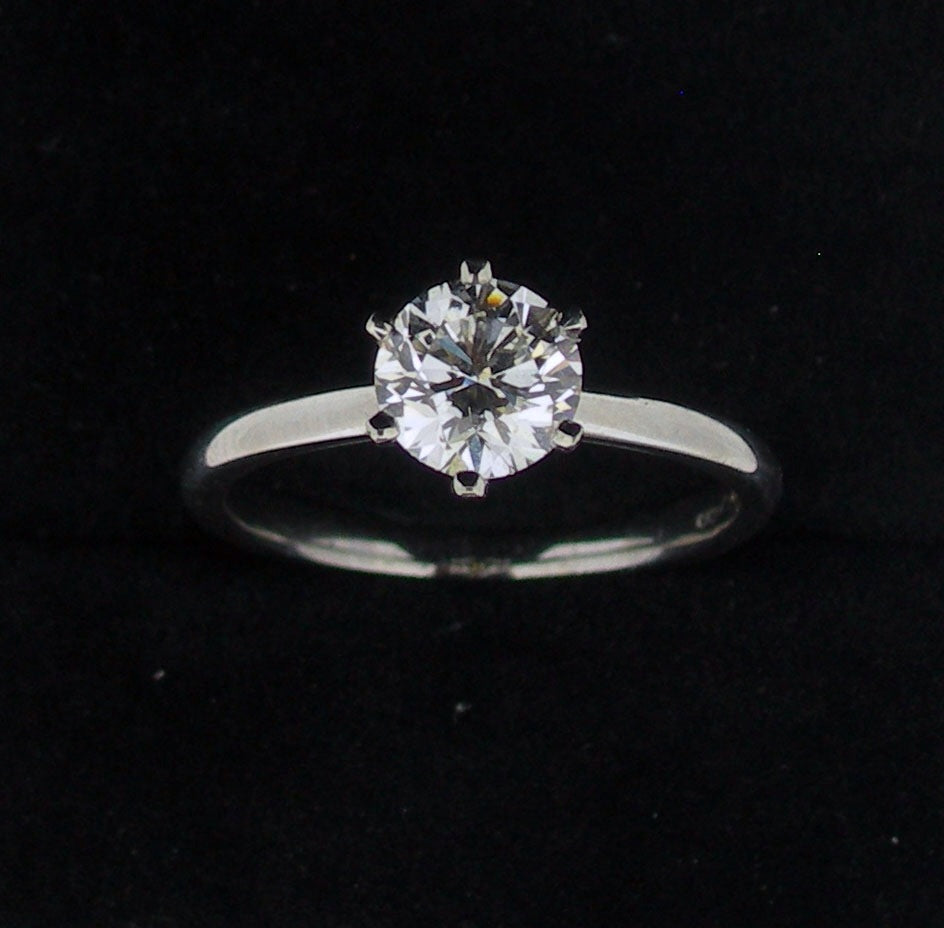 Six claw diamond solitaire ring