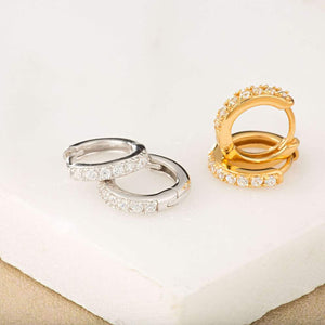 SP Huggie Earrings With Clear Stones Gold
