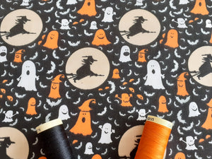 Halloween Witches & Ghosts Orange White on a Black Background Poly Cotton