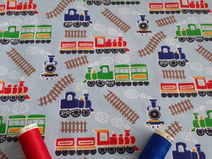 Steam Trains on a Sky Blue Background Poly Cotton