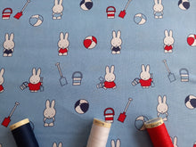 Load image into Gallery viewer, Miffy on Holiday Playing on the Beach on a Sky Blue Background Licenced 100% Cotton