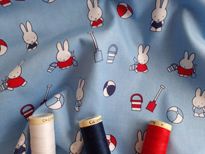 Miffy on Holiday Playing on the Beach on a Sky Blue Background Licenced 100% Cotton