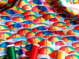 Bright Digital Print Rainbow Umbrellas on a Sky Blue Background 100% Cotton