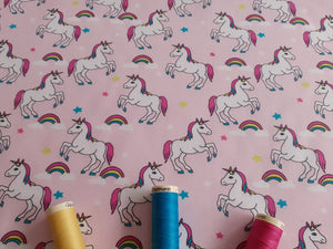 Unicorns & Rainbows Digital Print on a Baby Pink Background 100% Cotton