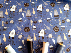 Rockets & Spaceships on a Denim Blue Background Poly Cotton