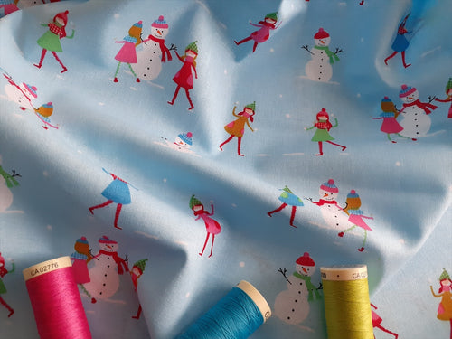 Christmas Town Snowman Multi Color on a Sky Blue Background 100% Cotton