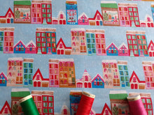 Load image into Gallery viewer, Christmas Town Houses Multi Color on a Sky Blue Background 100% Cotton