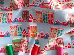 Christmas Town Houses Multi Color on a Sky Blue Background 100% Cotton