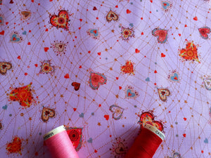 Quilting Treasures With Love Hearts Multi Colour on a Pink Background 100% Cotton