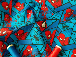 DC Comic Spiderman Mosaic on a Turquoise & Royal Blue Background - Licensed 100% Cotton