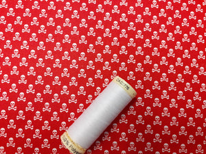 Ditsy White Skull & Crossbones on a Red Background  100% Cotton