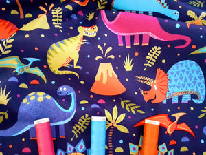 Dinosaur World Bright Colors on a Royal Blue Background 100% Cotton
