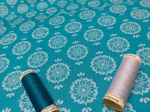 Indian Stamp Silver Grey on a Jade Background 100% Cotton