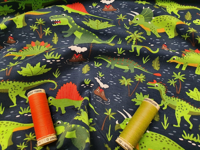 Dinosaur Kingdom Jersey Bright Green & Orange Mix on a Navy Background 95% Cotton, 5% Spandex