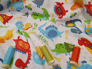 Dinosaur Friends Bright Colors on a White Background 100% Cotton