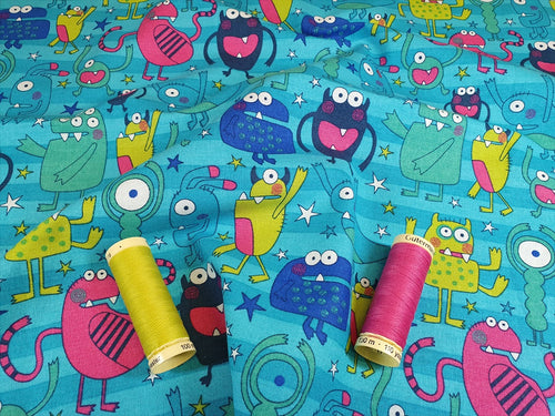Funny Monsters Multi Color on a Turquoise Background 100% Cotton