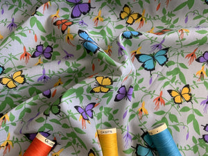 Bright Butterflies Yellow Lilac & Turquoise on a Silver Grey Background Poly Cotton