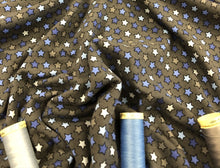 Load image into Gallery viewer, Star Multi Blue Colors Cotton Jersey on a Dark Grey Background 95% Cotton 5% Spandex