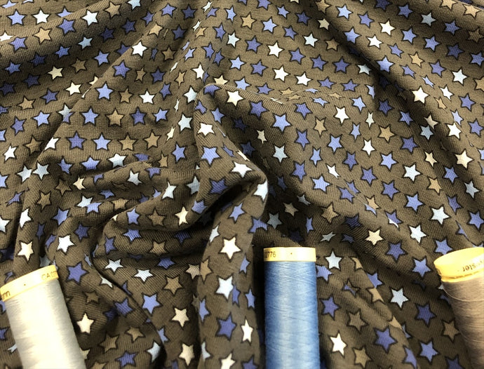 Star Multi Blue Colors Cotton Jersey on a Dark Grey Background 95% Cotton 5% Spandex