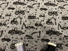 Load image into Gallery viewer, Loop Back Cotton Jersey Construction Vehicles on a Dark Grey Mottled Background