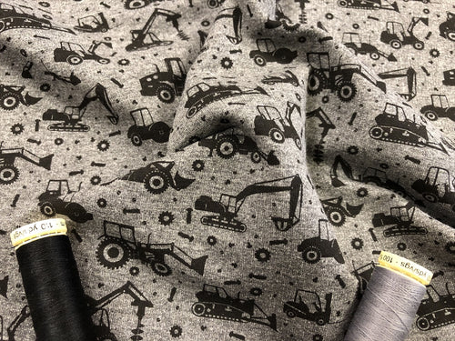 Loop Back Cotton Jersey Construction Vehicles on a Dark Grey Mottled Background