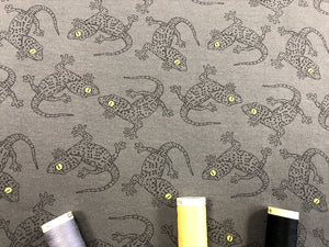 Loop Back Cotton Jersey Gecko's on a Dark Grey Background 62% Cotton 33% Polyester 5% Elastane