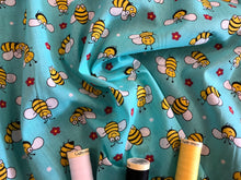 Load image into Gallery viewer, Busy Bumble Bees on a Aqua Green Background Poly Cotton