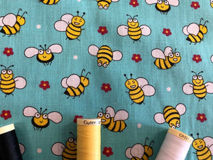 Busy Bumble Bees on a Aqua Green Background Poly Cotton
