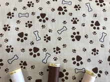 Load image into Gallery viewer, Dog Paws & Bones Brown on a Cream Background Poly Cotton