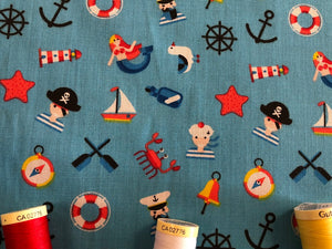 Pirates Mermaids & Nautical Notions on a Turquoise Background Poly Cotton