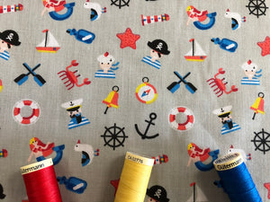 Pirates Mermaids & Nautical Notions on a Silver Grey Background Poly Cotton