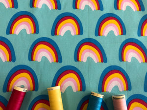 Bright Color Rainbows on a Aqua Green Background Poly Cotton