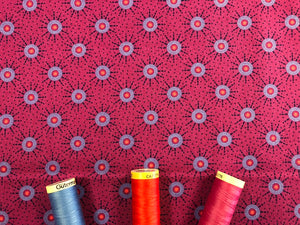 Makoti Collection by Stuart Hillard Purple Circles on a Fushia Pink Background 100% Cotton
