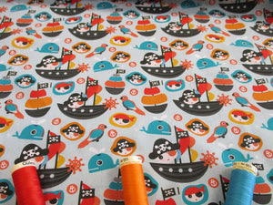Pirates & Ships Digital Printed on a Sky Blue Background 100% Cotton
