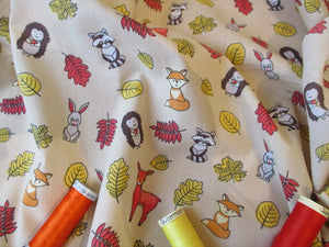 Woodland Animals on a Biege Background Poly Cotton