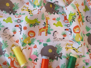 Jungle Animals on a White Background Poly Cotton