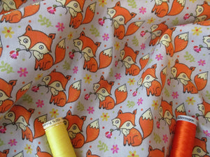 Little Orange Foxes on a Light Grey Background Poly Cotton