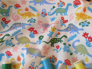 Dinosaurs on a White Background Poly Cotton