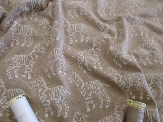 Jersey Zebras on a Beige Background 95% Cotton 5% Elastane