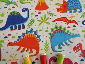 Dinosaur World Bright Colors on a Cream Background 100% Cotton