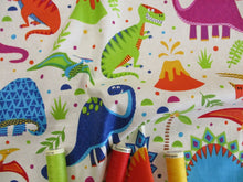 Load image into Gallery viewer, Dinosaur World Bright Colors on a Cream Background 100% Cotton
