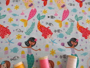 Mermaids & Sea Life Bright Colors on a Aqua Background 100% Cotton